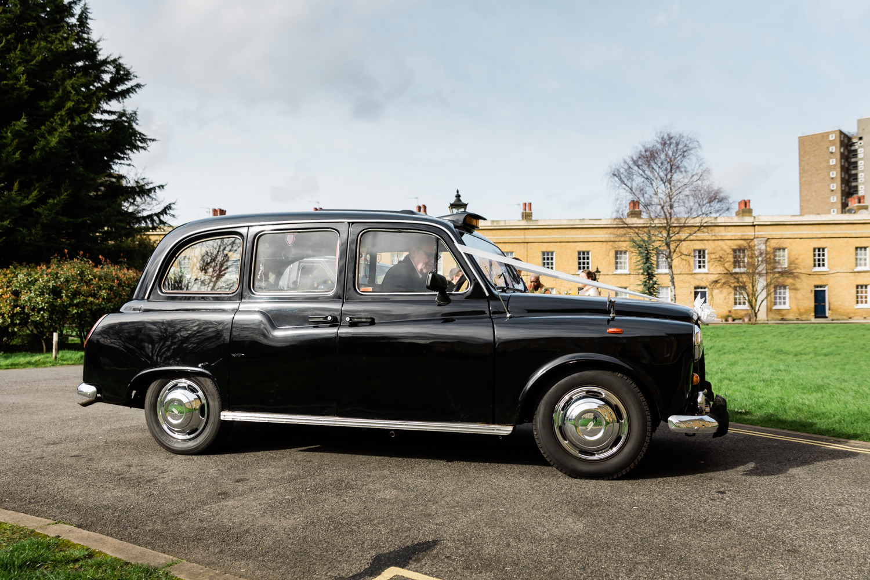 Black cab wedding arrival